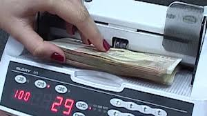 DIICOT Braşov a destructurat un grup infracţional specializat în fraude bancare