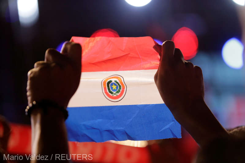 A supporter of Colorado Party's presidential candidate Mario Abdo Benitez holds a Paraguayan flag while attending a campaign rally ahead of the April 22 election in Itaugua
