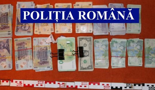 Bărbat bănuit că ar fi autorul unei tâlhării de la o casă de schimb valutar, reţinut de poliţişti