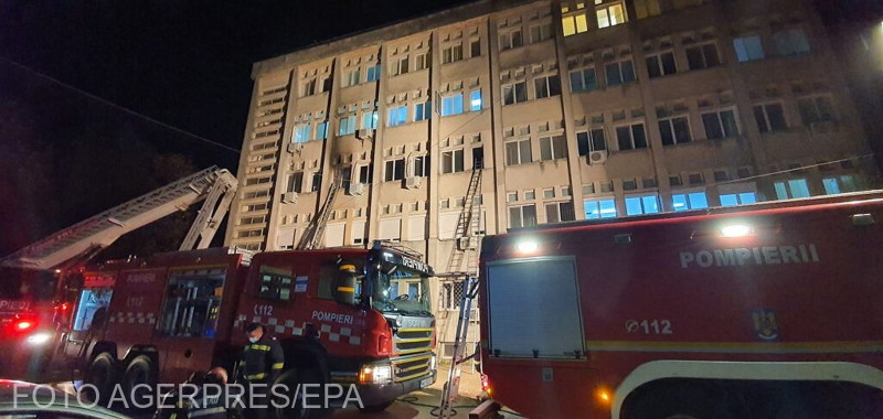 Romanian firemen fight fire at the emergency care unit of a COVID-19 hospital in north-eastern Romania